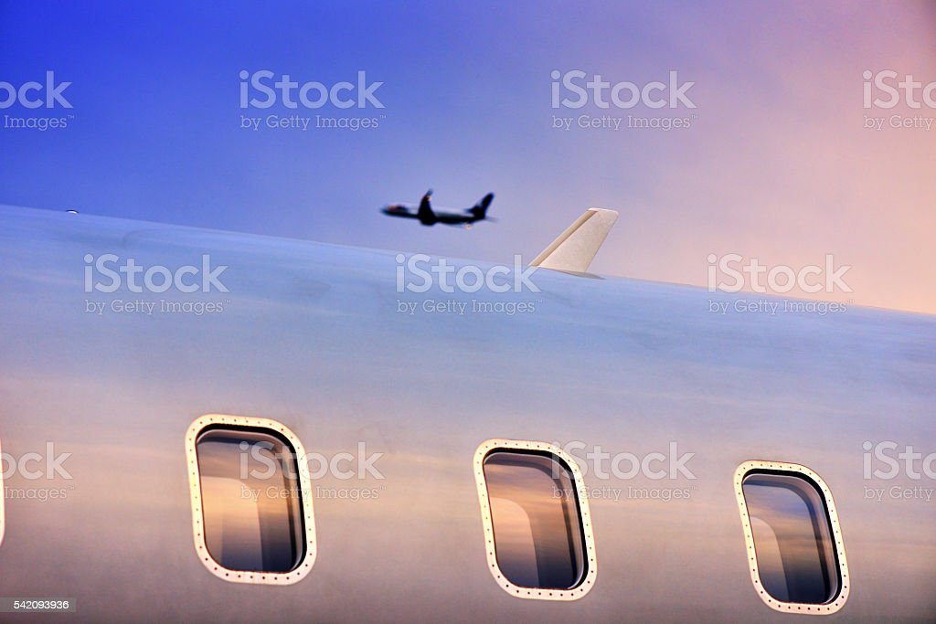 Aircraft flying over the airport stock photo