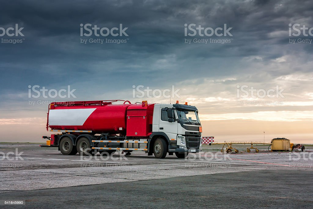 Aircraft fueler on the cloudy morning airport apron royalty-free stock photo