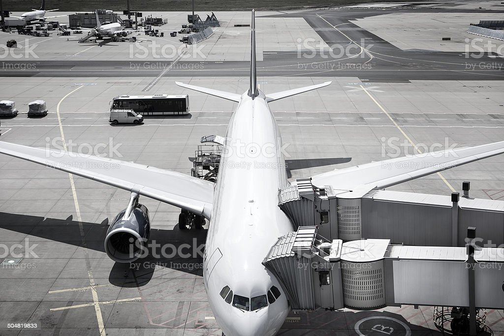 Aircraft ground handling at a busy Airport, view from above stock photo