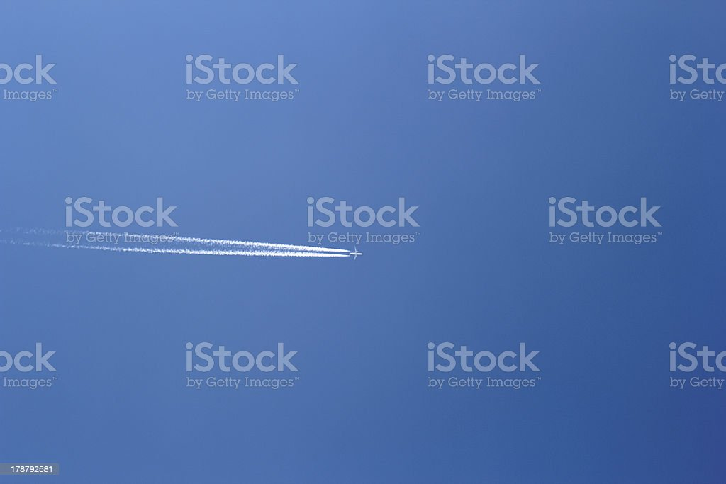 aircraft in a clear blue sky royalty-free stock photo