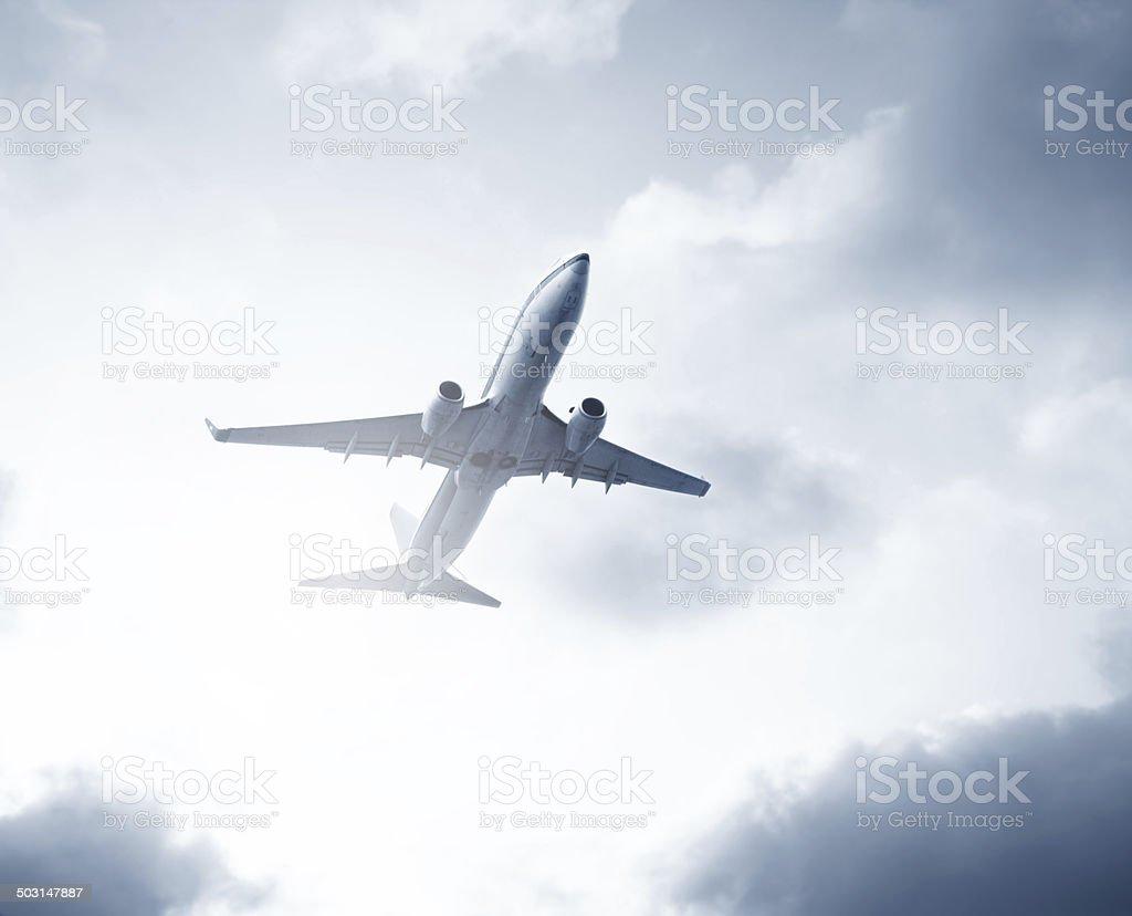Aircraft in flight stock photo