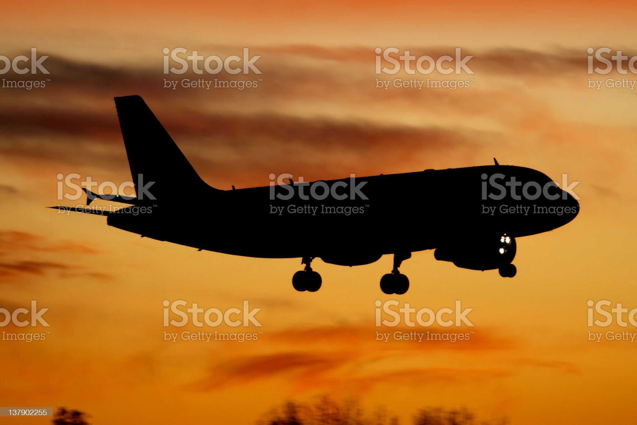 Aircraft landing at sunset royalty-free stock photo