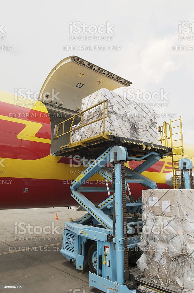 DHL aircraft loading freight stock photo