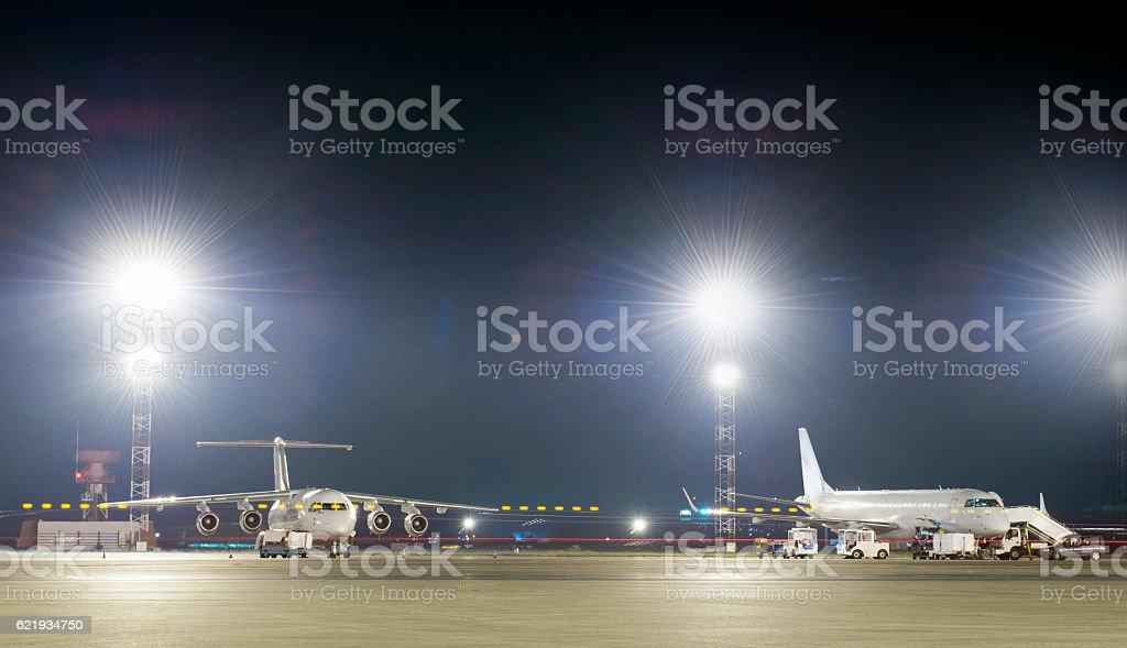 Aircraft maintenance at night stock photo