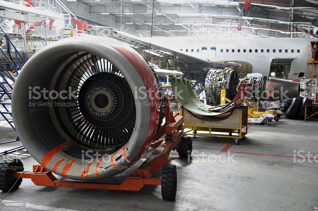 Aircraft maintenance in hangar stock photo