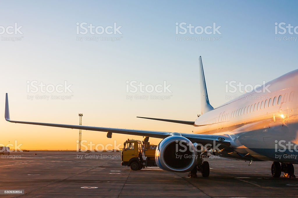 Aircraft maintenance in the morning airport apron stock photo