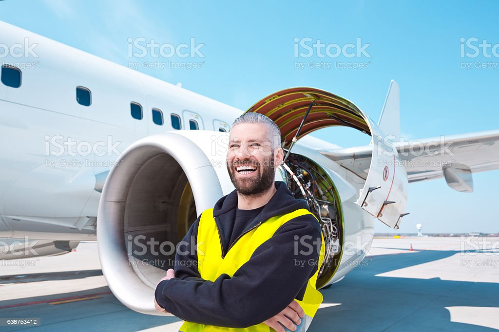 Aircraft mechnic in front of aircraft engine stock photo