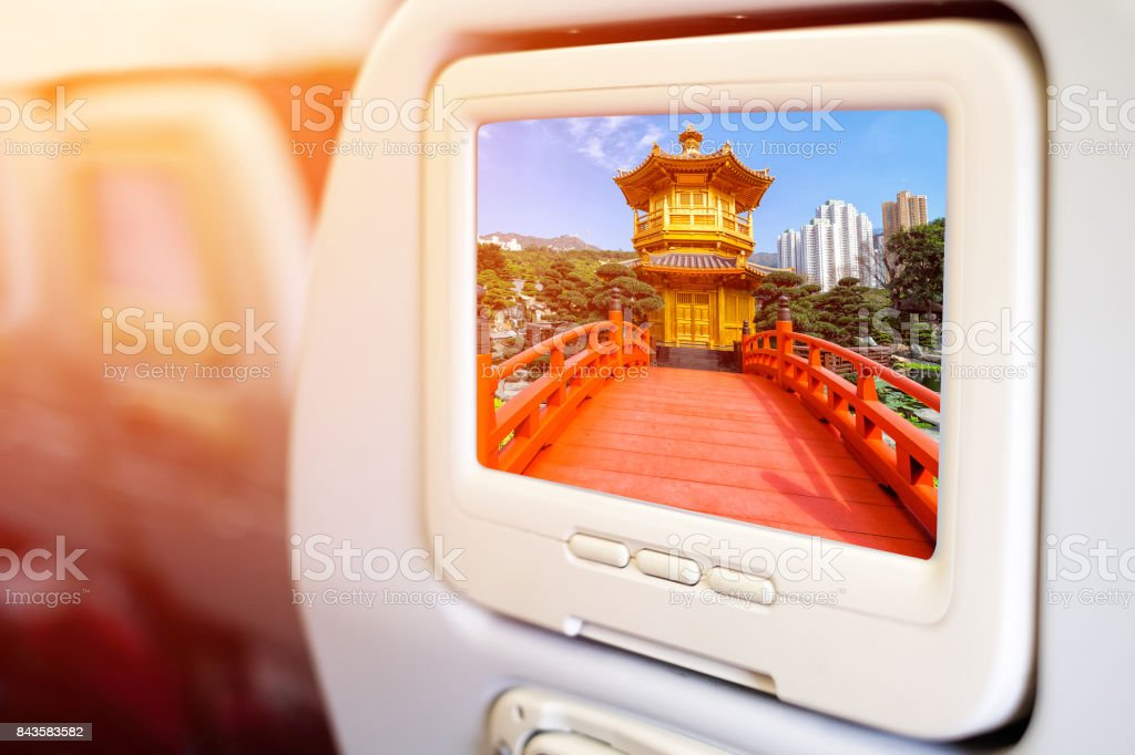 Aircraft monitor in front of passenger seat showing Front View The Golden Pavilion Temple in Nan Lian Garden stock photo