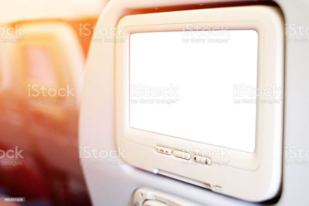 Aircraft monitor in passenger seat isolated on white background with clipping path stock photo