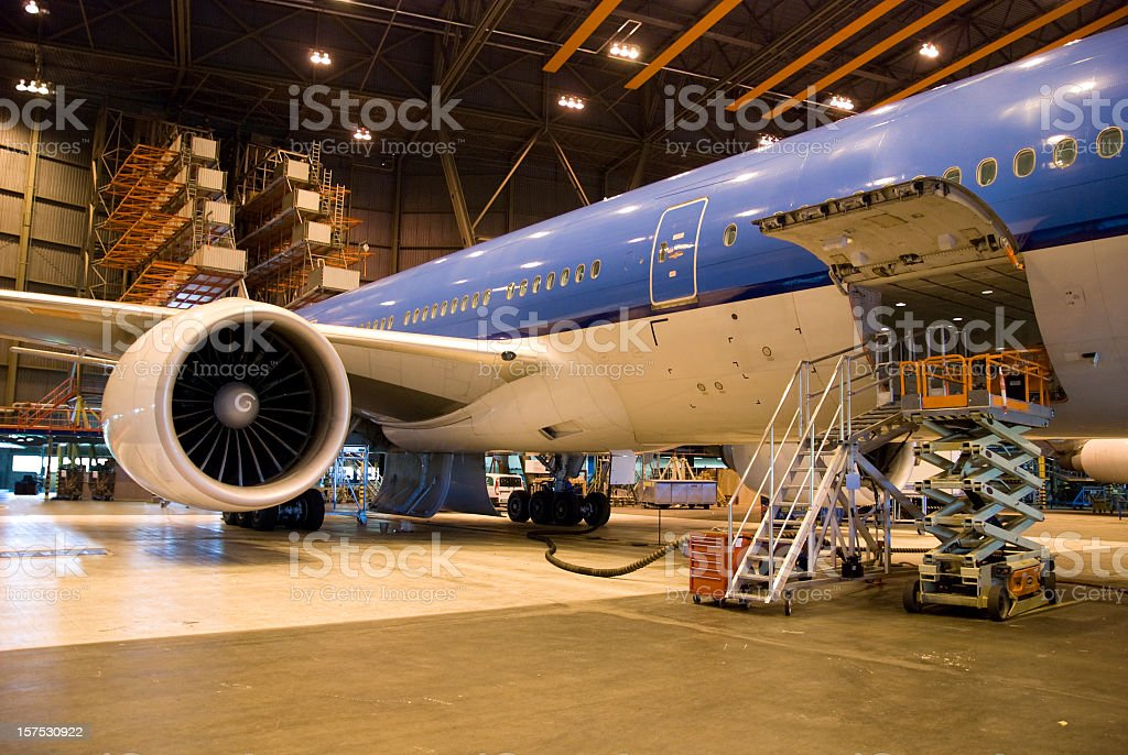 Aircraft parked in a Hangar for maintenance stock photo