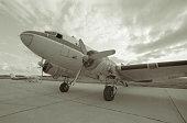 DC-3 Aircraft Parked on Runway Tarmac