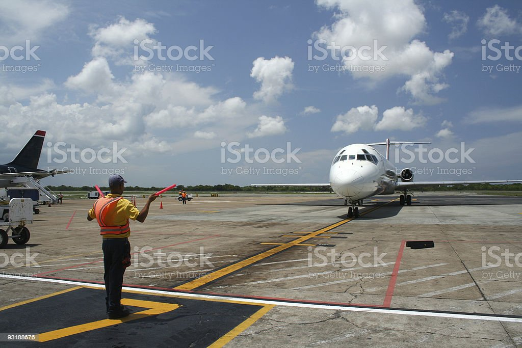 Aircraft parking at airport terminal royalty-free stock photo