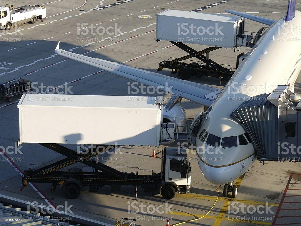 Aircraft receiving ground service stock photo