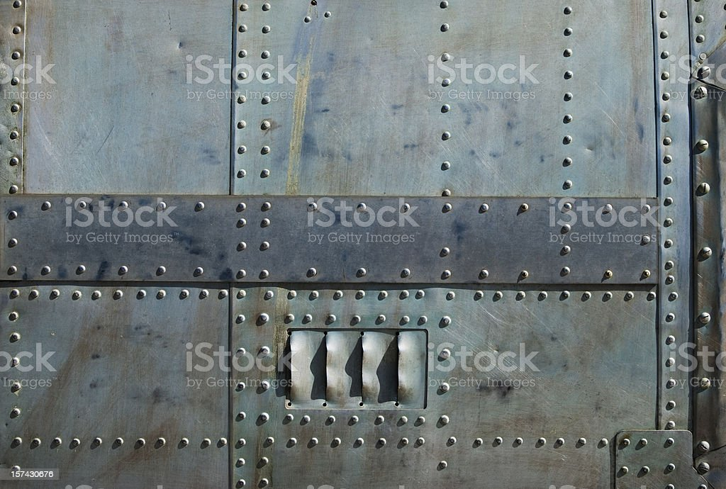 Aircraft siding with rivets royalty-free stock photo