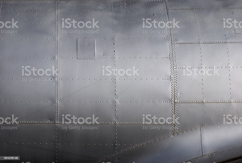 Aircraft siding with rivets royalty-free stock photo