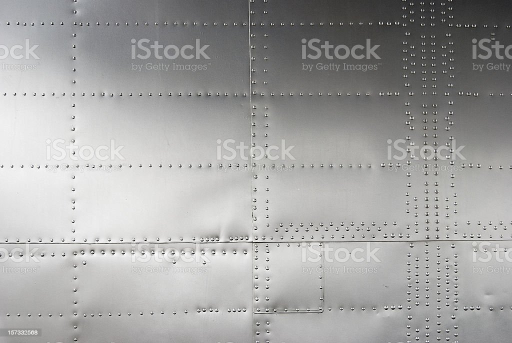 Aircraft siding with rivets, background stock photo