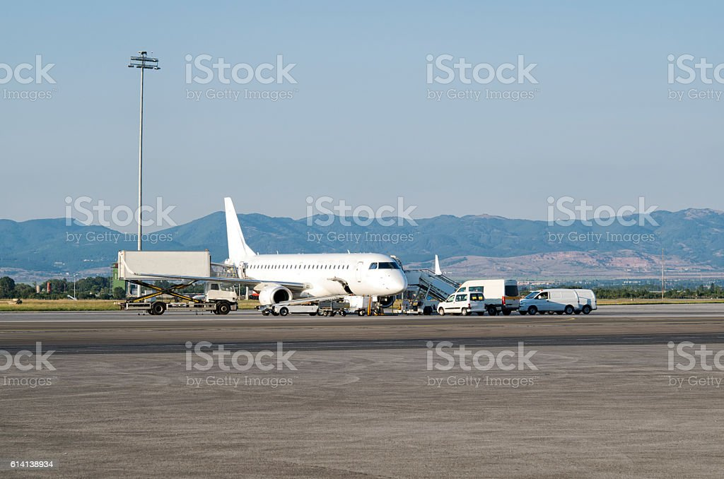Aircraft standing on the handling ramp stock photo