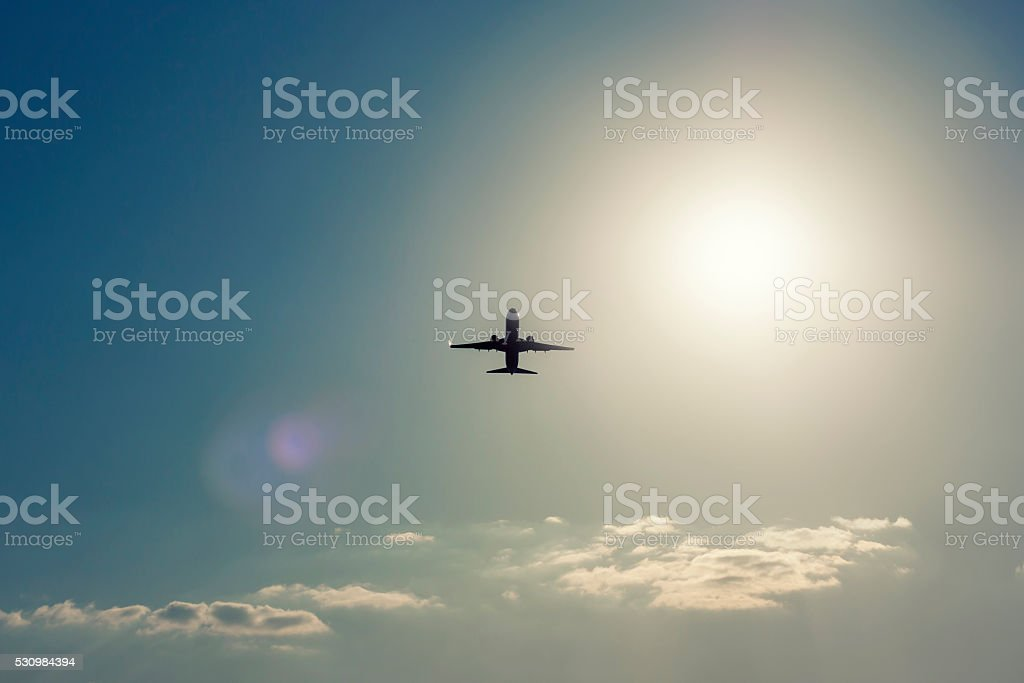 Aircraft take off in backlight stock photo