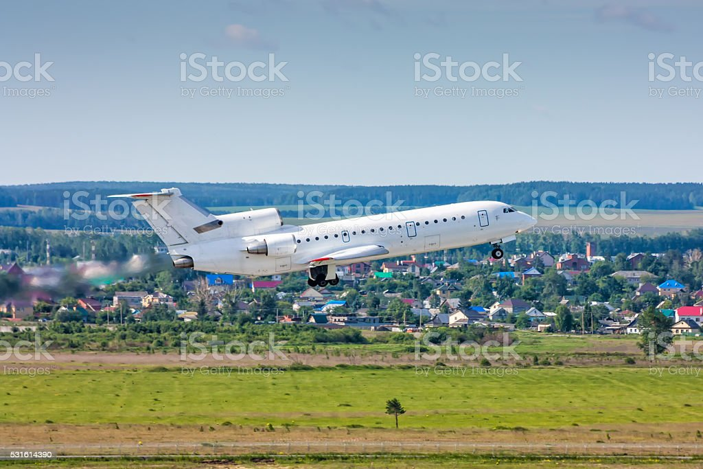 Aircraft taking off in a blue sky royalty-free stock photo
