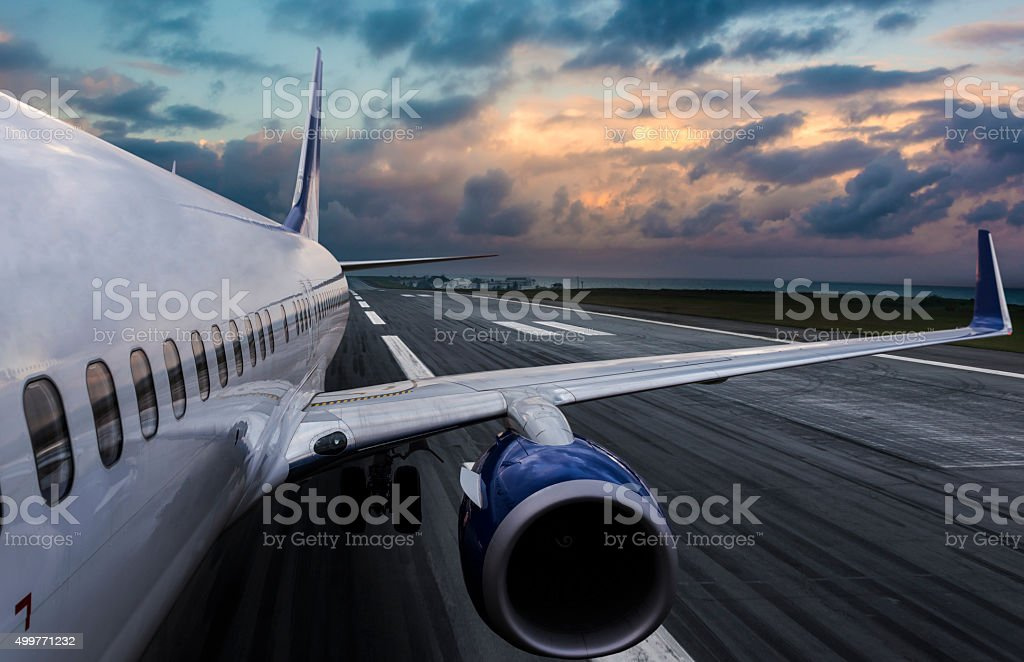 Aircraft taking off on runway stock photo