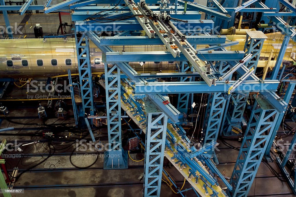 Aircraft under construction in aerospace workshop stock photo