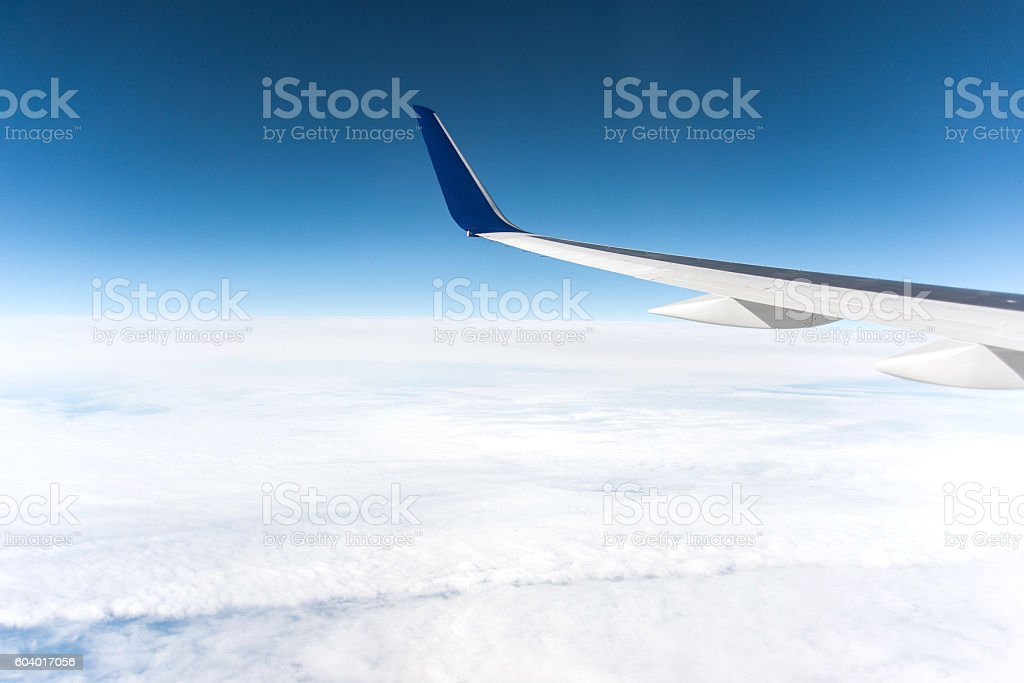 aircraft wing before blue sky stock photo