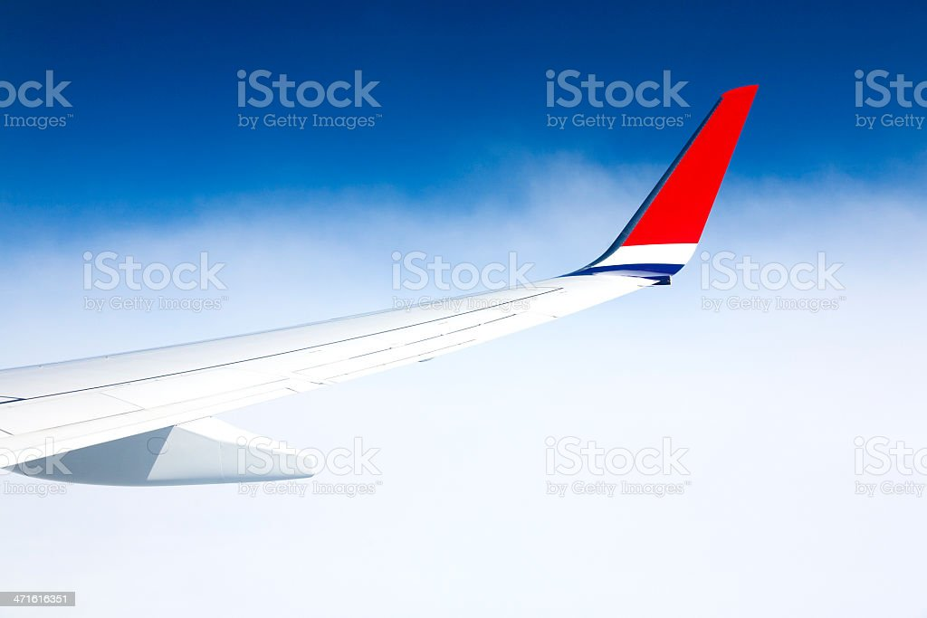 Aircraft wing during flight royalty-free stock photo