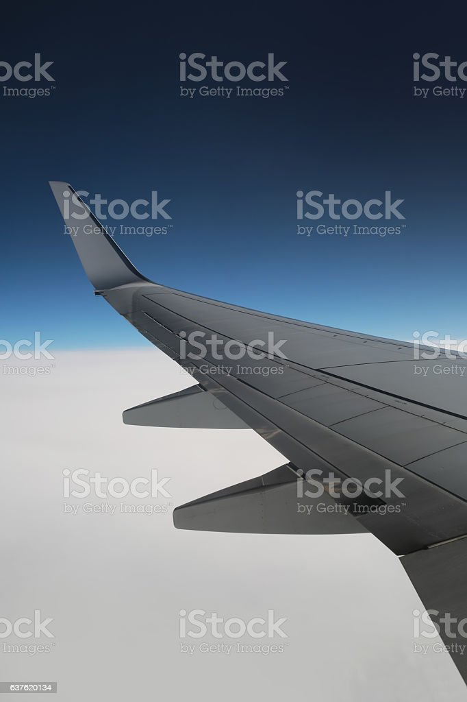 Aircraft wing on the clouds, Flying background vertical stock photo