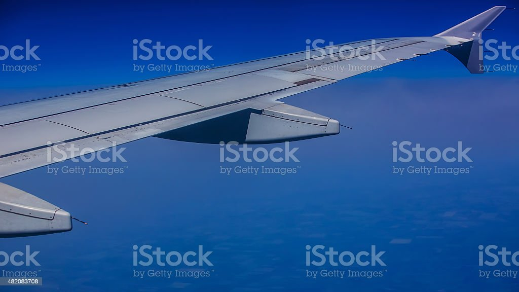 Aircraft wing on the clouds stock photo