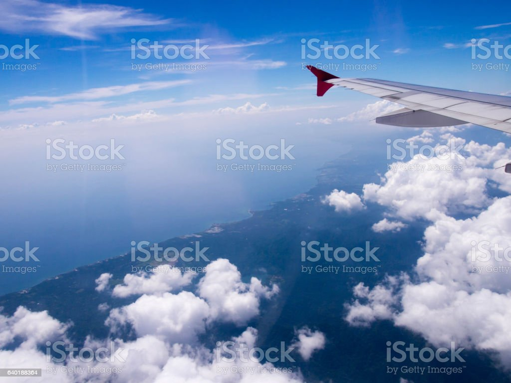 Aircraft wing with bluesky from windows view. stock photo