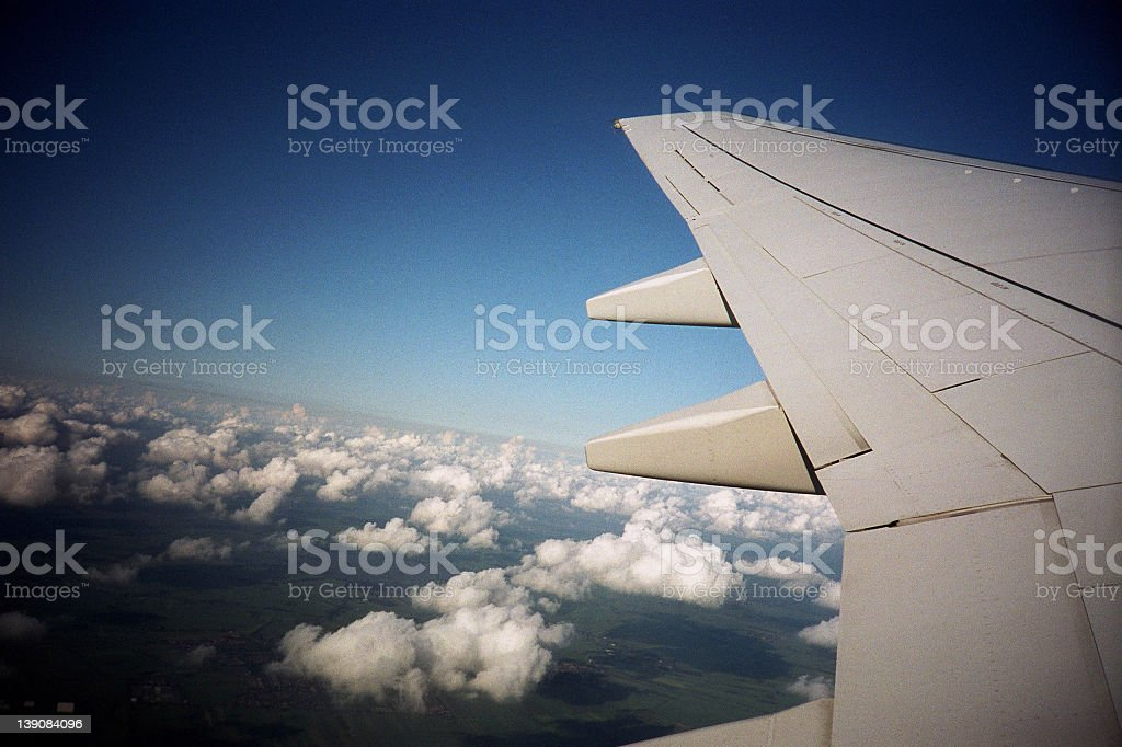 Aircraft wings during the flight royalty-free stock photo