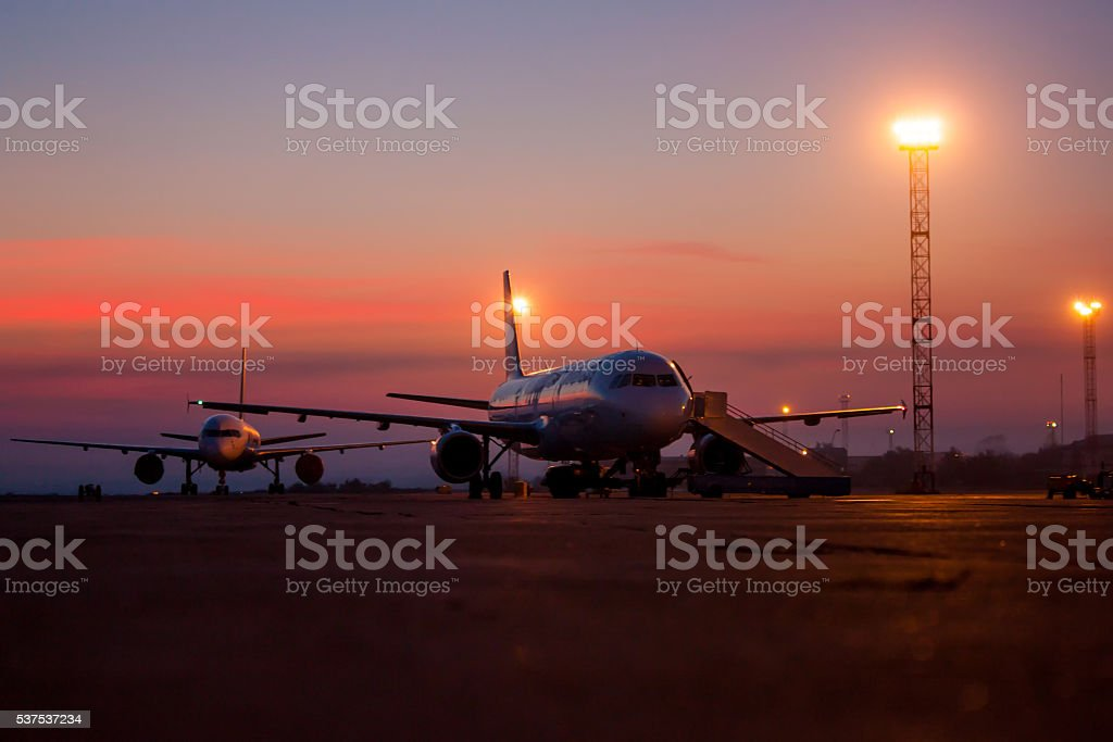 Aircrafts on the airport apron early morning royalty-free stock photo