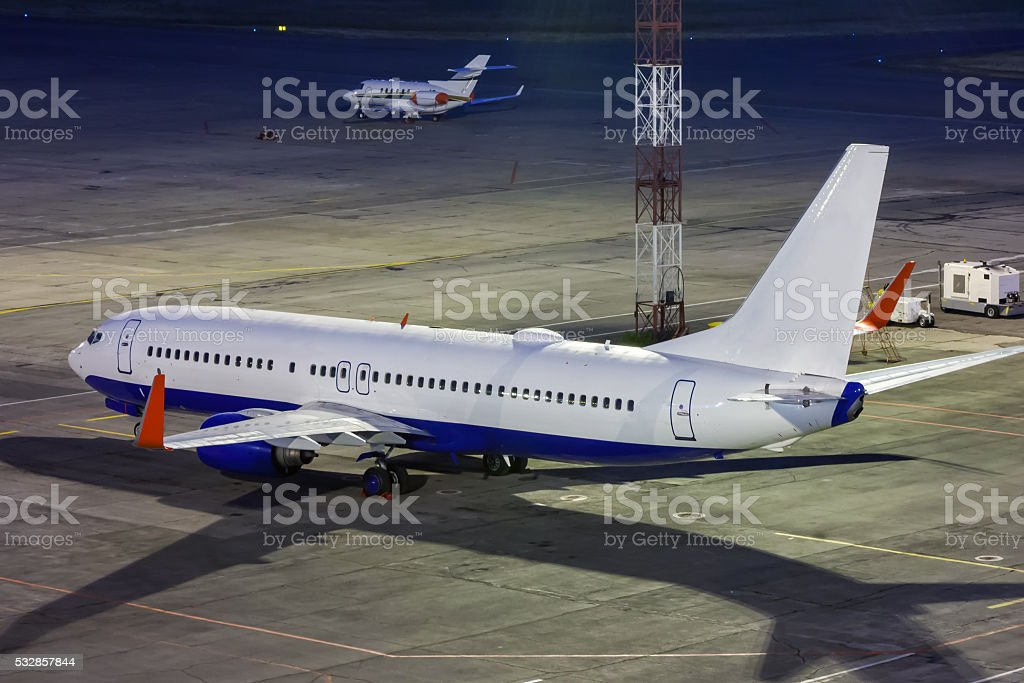 Aircrafts on the airport apron in the night royalty-free stock photo