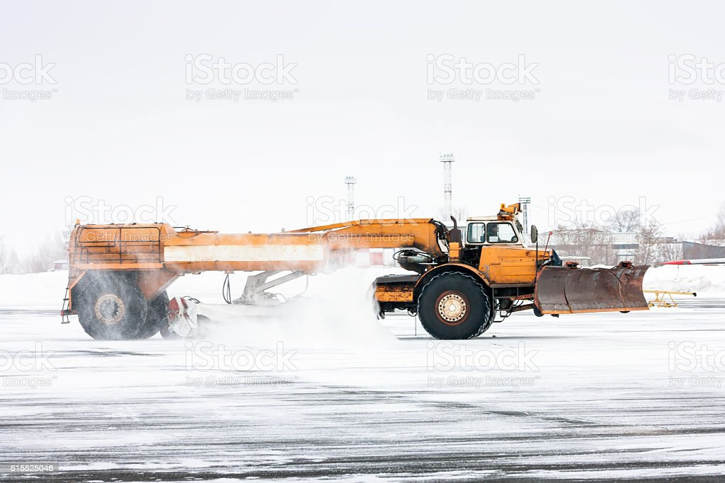 Airfield sweeper cleans the Runway stock photo