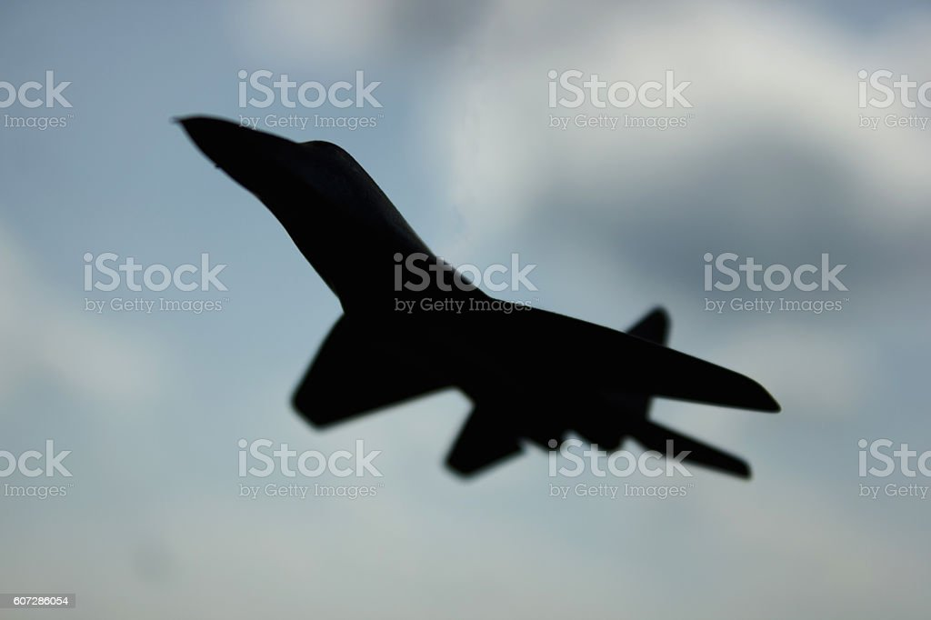 Air-fighter's profile against the sky stock photo