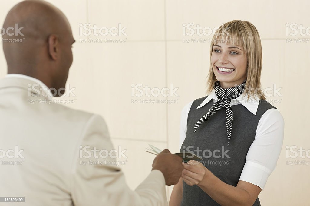 Airline Attendant Hands Documentation Back to a Businessman royalty-free stock photo