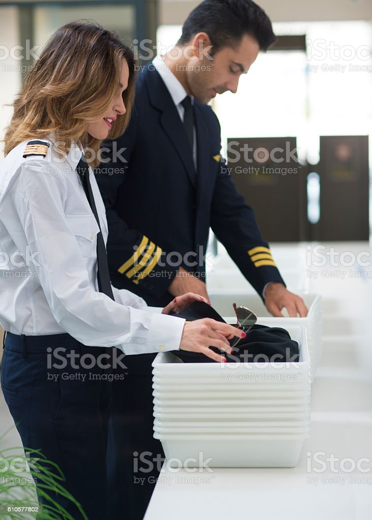 Airline crew going through security check stock photo