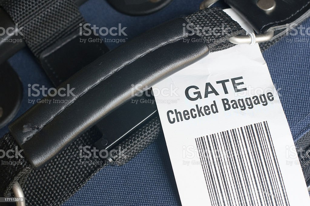Airline gate-checked baggage label. stock photo