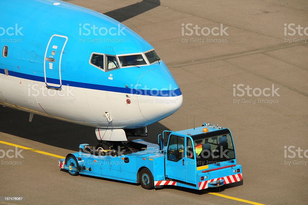 Airline industry - towing to runway stock photo