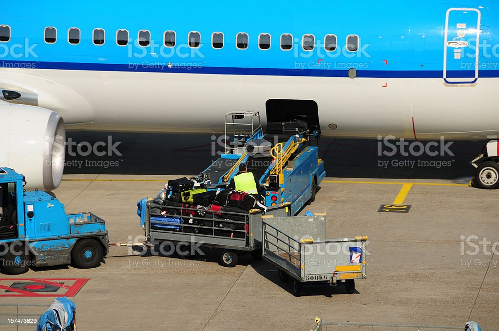 Airline industry - transporting luggages royalty-free stock photo