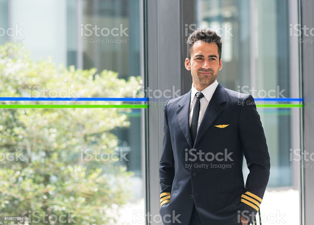 Airline pilot in airport terminal stock photo