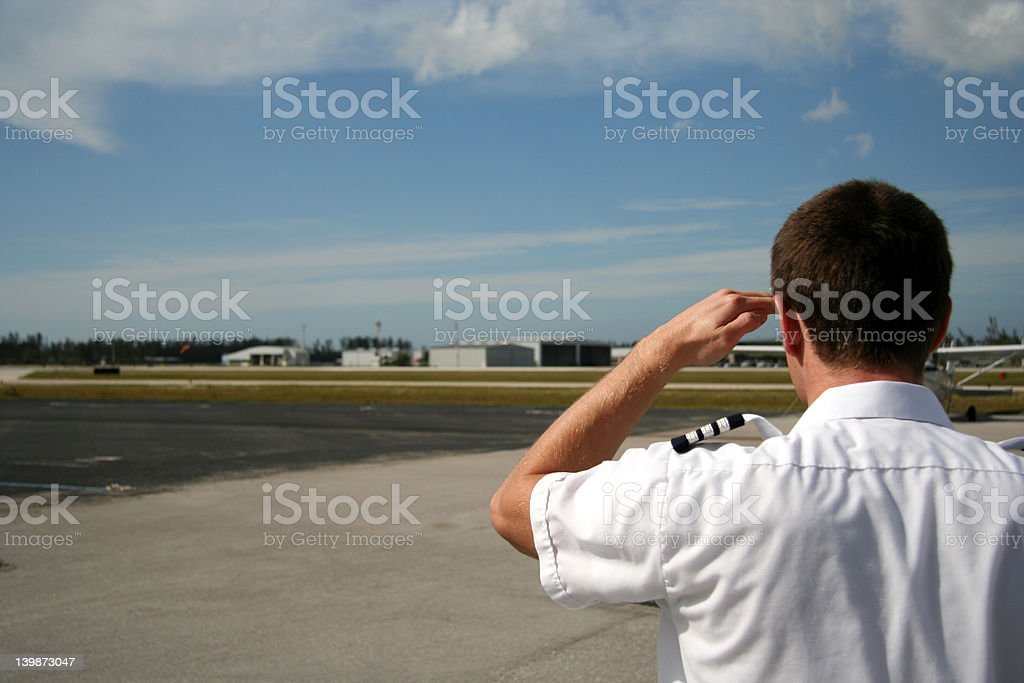 Airline pilot looking for his plane royalty-free stock photo