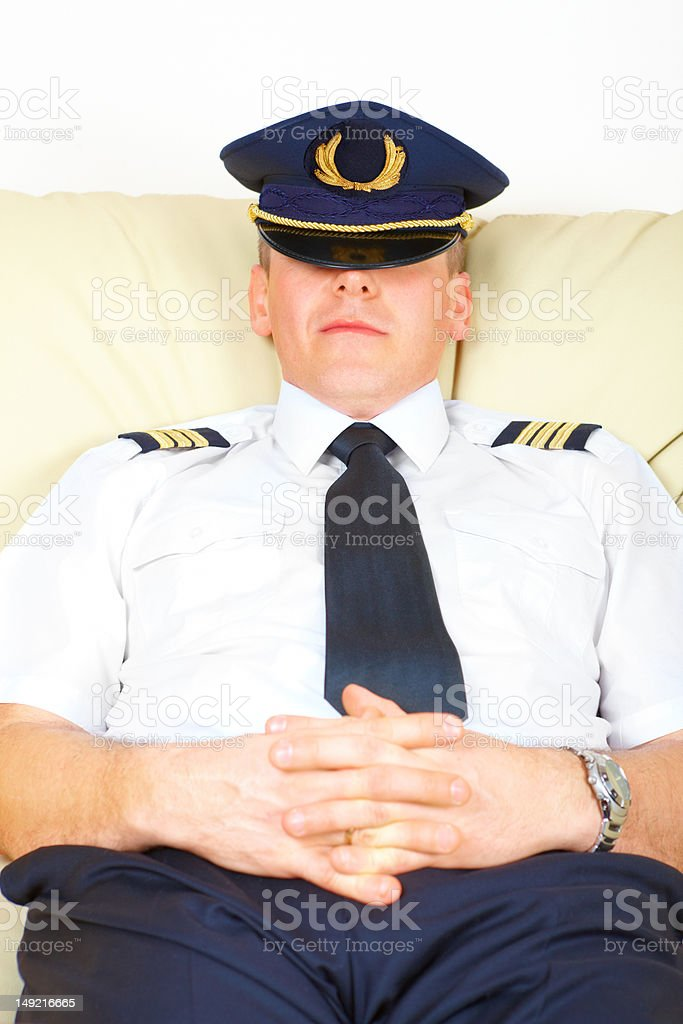 Airline pilot resting stock photo