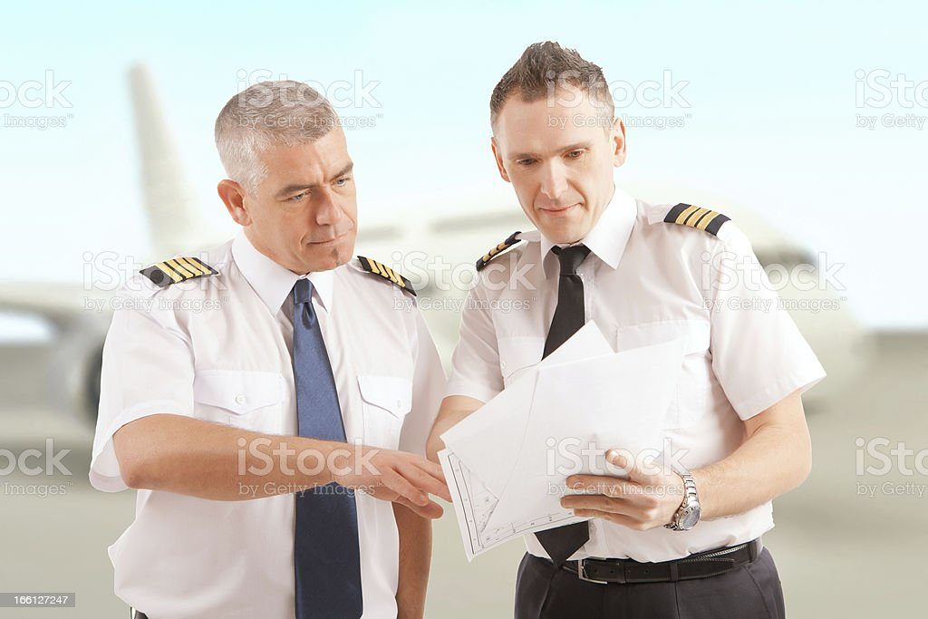 Airline pilots at the airport stock photo