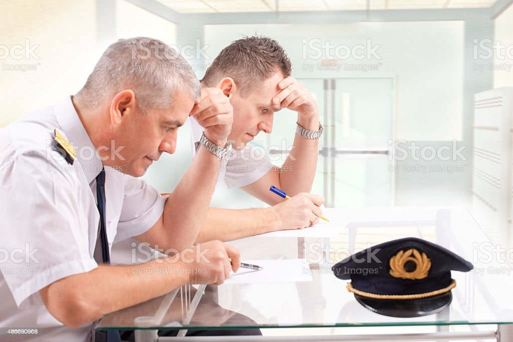 Airline pilots during exam stock photo