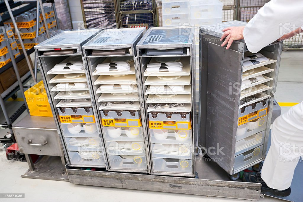 Airline service trolleys equipped with dishes stock photo