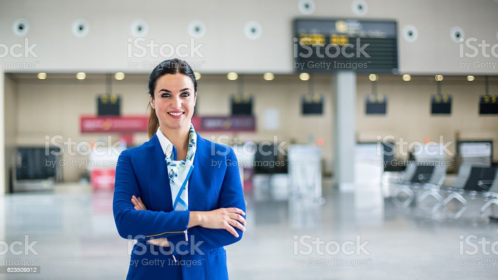 Airline stewardess in airport lounge stock photo