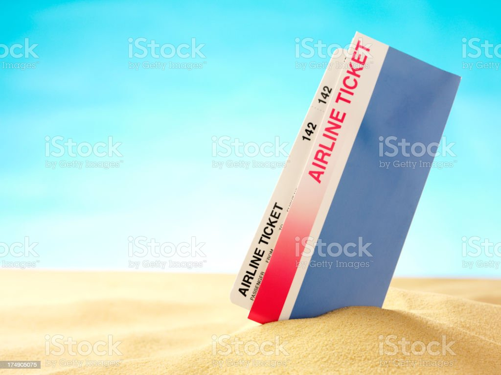 Airline Ticket in the Sand on a Beach royalty-free stock photo