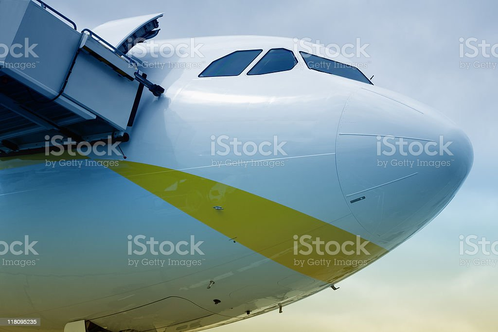 Airliner and Boarding Stairs at Airport stock photo