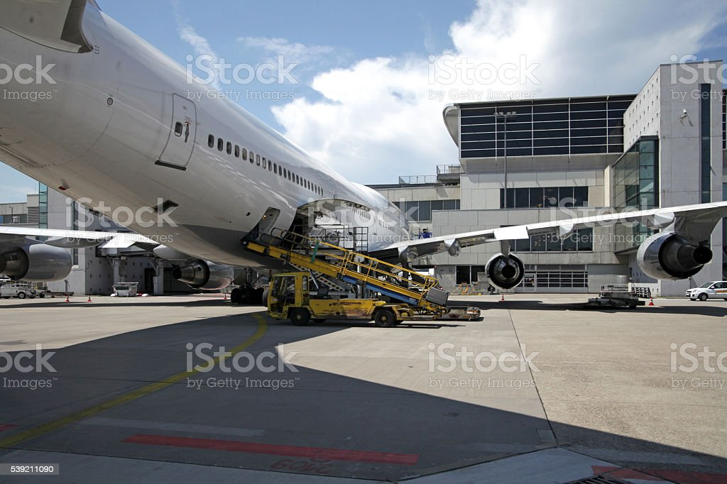 Airliner at gate being loaded stock photo